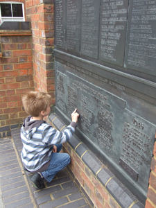 Child studying a war memorial © J Peach-Miles, 2012