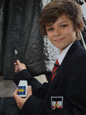 Secondary school pupil applying SmartWater to a war memorial © Duncan Soar Photography, 2012