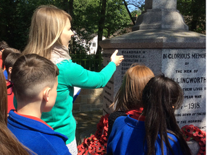 War Memorial Trust's Learning Officer and yr 6 pupils from Hollingworth Primary visitng the Hollingworth war memoral c. S Featherston, 2018