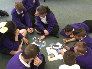 Yr 6 pupils at Denbigh Community Primary School looking at images of war memorials © Denbigh Community Primary School, 2018