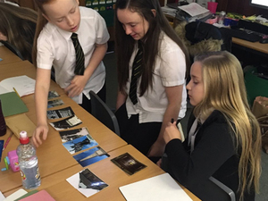 P7 pupils from SS Peter and Paul's RC Primary School looking at war memorial images © SS Peter and Paul's RC Primary, 2018