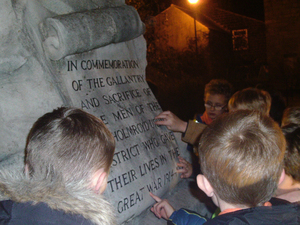 Mytholmroyd Cubs looking at Men of Mytholmroyd District war memorial during night time visit © War Memorials Trust, 2018