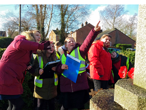 Year 5 and 6 pupils from Cockshutt CofE Primary School looking at Cockshutt war memorial with WMT Learning Officer © Martin Phillips, 2019