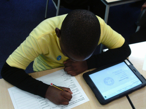Year 4 pupil from Kings Avenue School researching names on local war memorials © War Memorials Trust, 2019