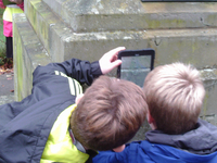 Pupils from Melrose Primary School taking photographs of Melrose war memorial for condition survey ©War Memorials Trust, 2017