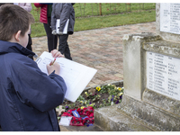Yr 6 pupil from John Randall Primary School recording names from Madeley war memorial to research © Lucy Millson/Watkins/Historic England, 2018