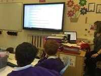 Yr 6 pupils and WMT's Learning Officer uploading the condition survey results to War Memorials Online © Denbigh Community Primary School, 2018