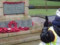 Year 5 pupils from Moorhouse Primary School photographing Milnrow war memorial, Rochdale during condition survey © War Memorials Trust, 2019
